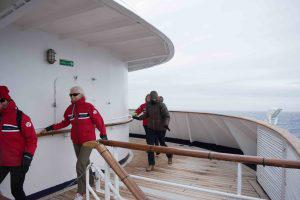 Holding the railings while in the Drake Passage.