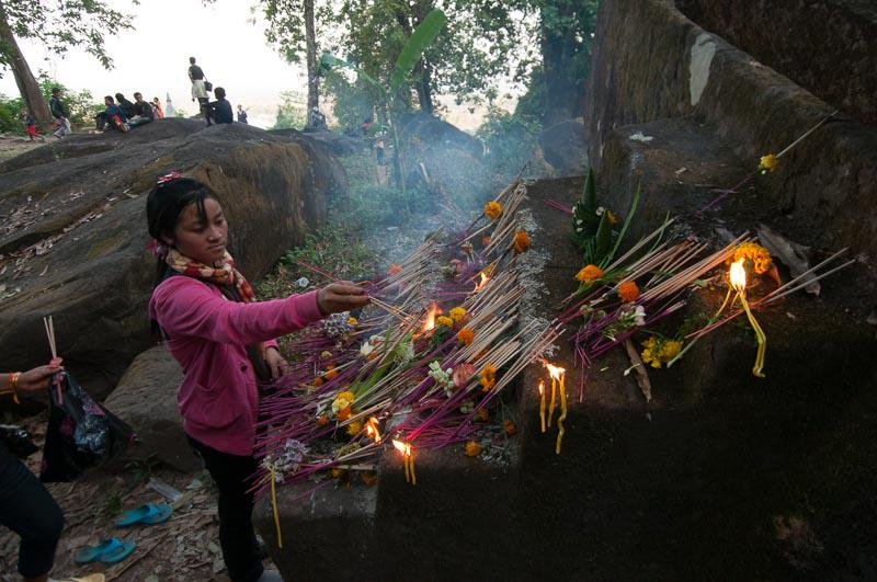 Woman Offering Prayers in Laos