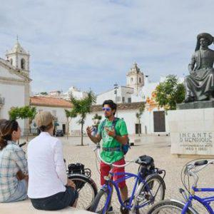 A Hidden Places bike guide gives guests a city tour in Portugal.