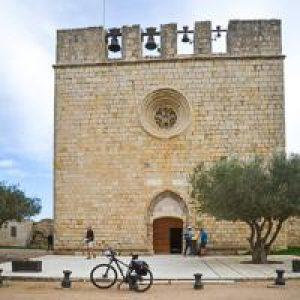 A castle in Spain with a bicycle in front on a Hidden Places trip.