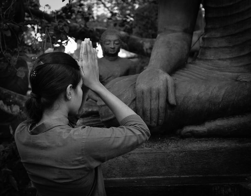 Praying in Buddhist Statue