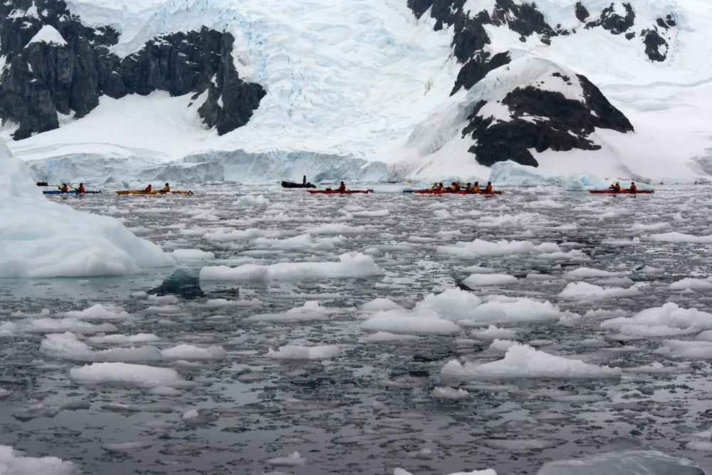Kayaking with crackling sea ice